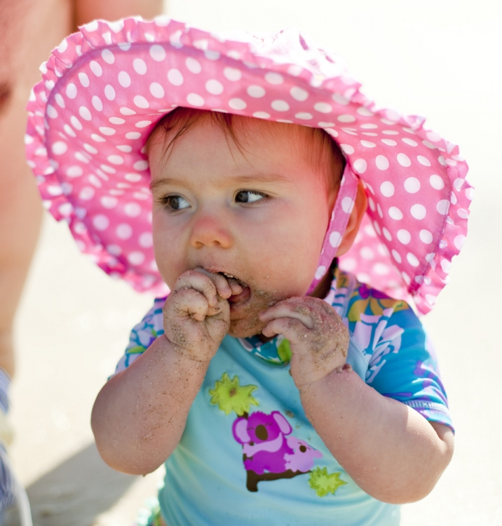 Lilia eating sand at Henley Beach