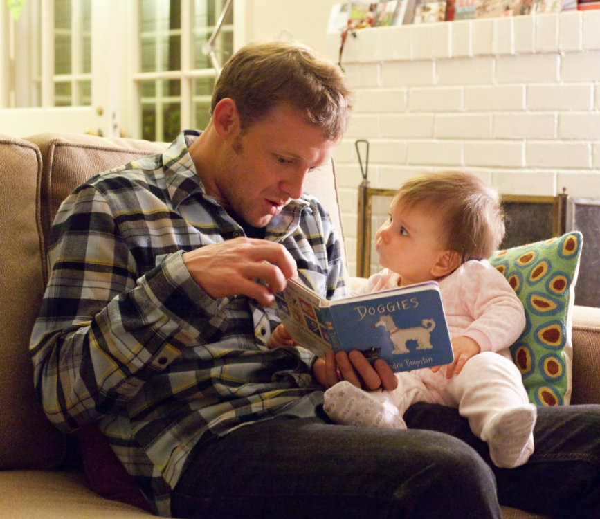 Kevin and Lilia with Lilia's favorite book