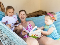 Anna, Lisa and Lilia enjoying some stories in the hammock