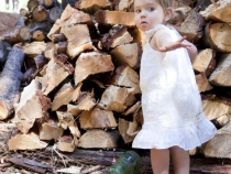 Helping Dad stack the wood pile