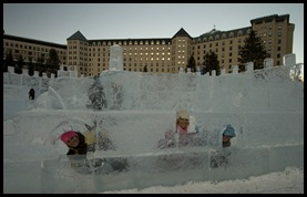 The girls in the ice castle in front of the Fairmont Lake Louise