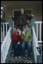 Greg with the girls on our front porch