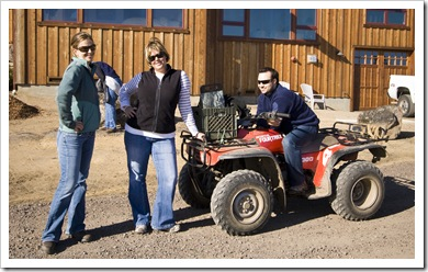 Lisa, Andi and Jeffrey with the four-wheeler ready