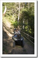 Lisa and Michaela on the four-wheeler in the woods