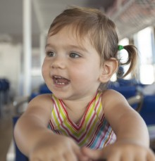 Lilia excited on the ferry to Moorea