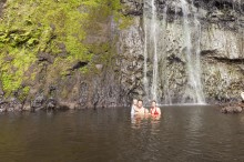 The Bakkers swimming in the pool at the base of Atiraa Falls