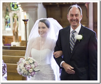 Bob proud with his daughter walking down the aisle