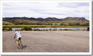 Lisa hopping on the bike at the Missouri River near Wolf Creek