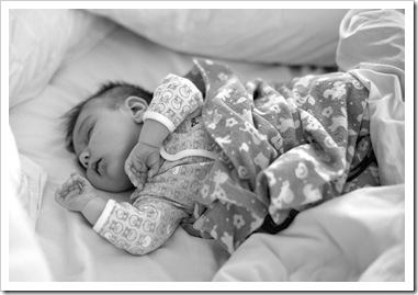 Lilia asleep in Mum and Dad's bed