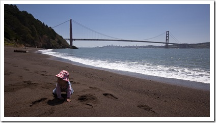 Lilia on the beach in Kirby Cove with the Golden Gate Bridge in the background