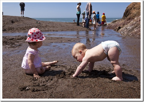 Lilia and Samuel enjoying the sand